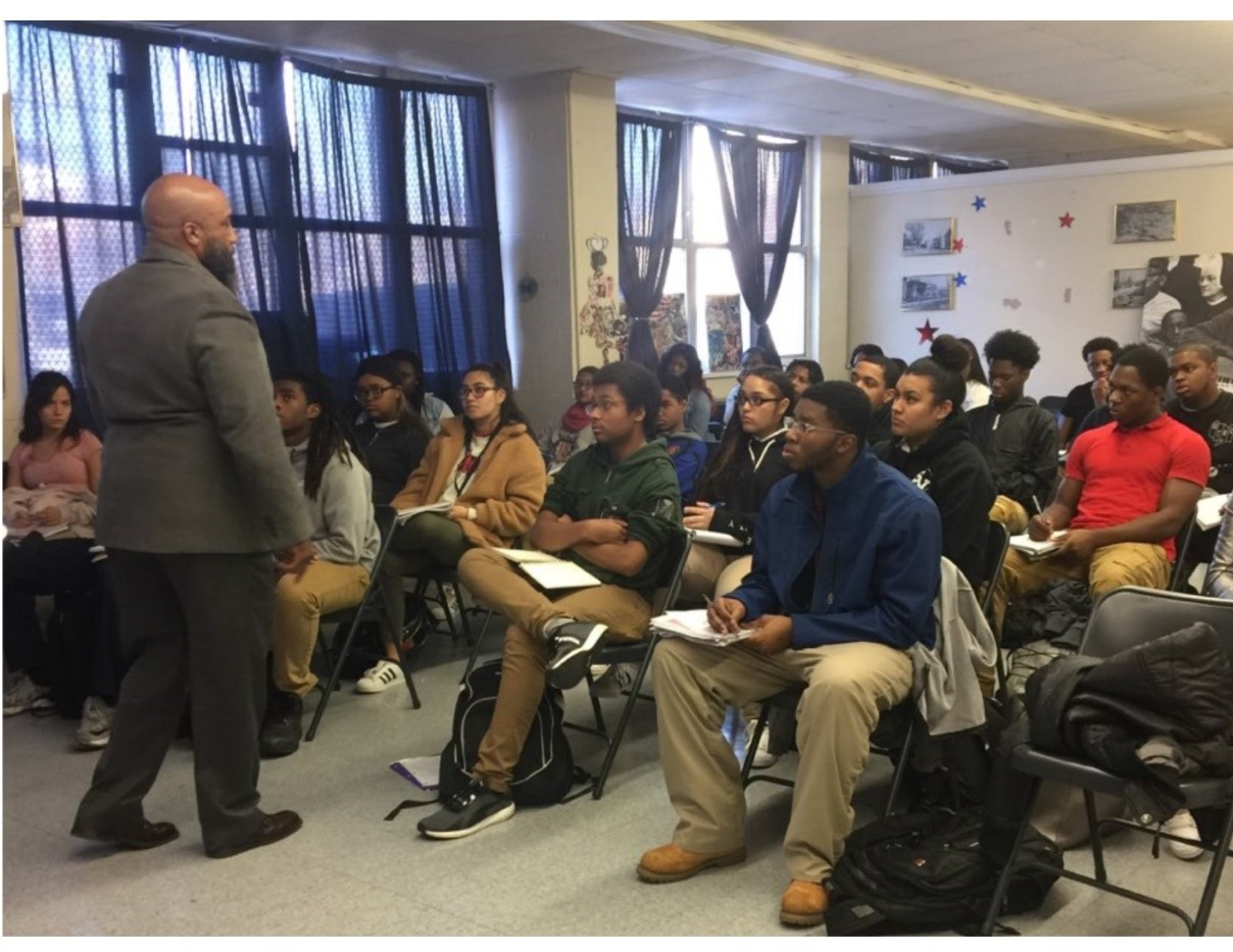 Civic Trustee lectures at a Solutions Civics pilot course at American History High School